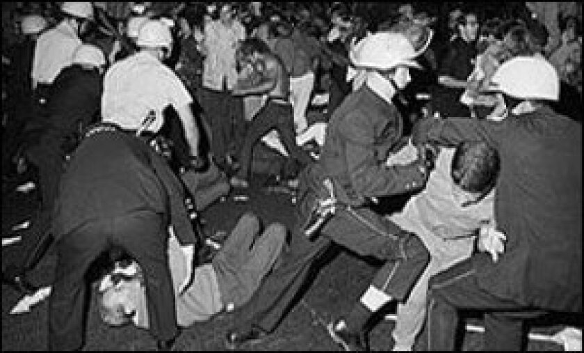 Police detain rioters in Chicago in 1968 during the Democratic National Convention.