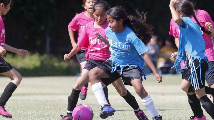Costa Mesa Victoria Elementary's Aisleen Avalos, center, competes against Costa Mesa Whittier in a g