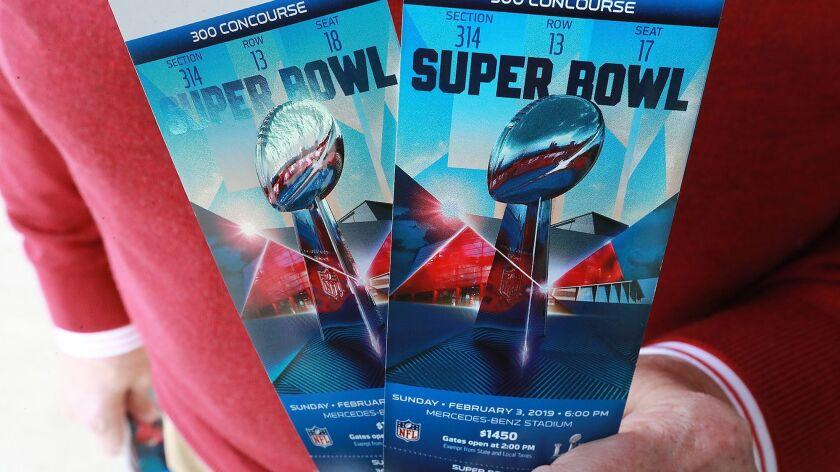 Bob Prather of Atlanta picks up his Super Bowl tickets at the Mercedes-Benz Stadium ticket window on Jan. 22.