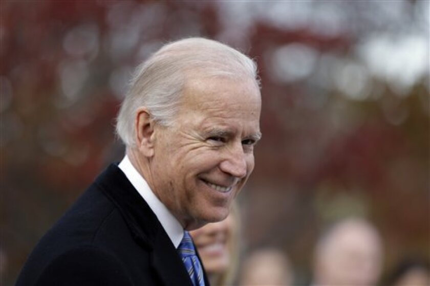 This 2012 file photo shows Vice President Joe Biden speaking with members of the media in Greenville, Del. Within the last few days, two women have come forward with allegations that Biden touched them inappropriately at political events.