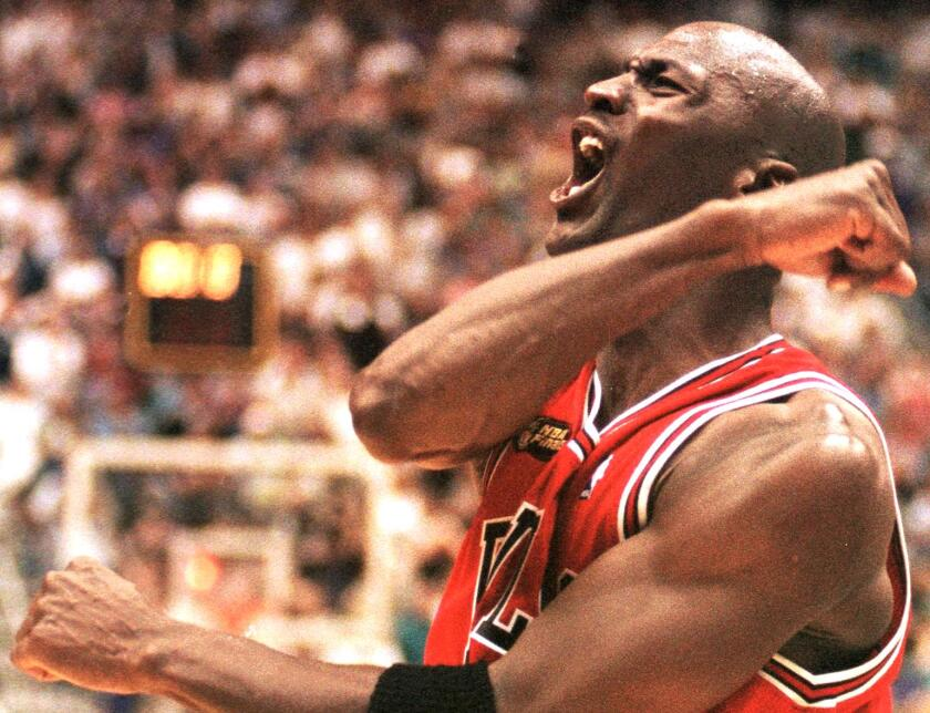Michael Jordan celebrates after the Chicago Bulls clinched their sixth NBA title in 1998.