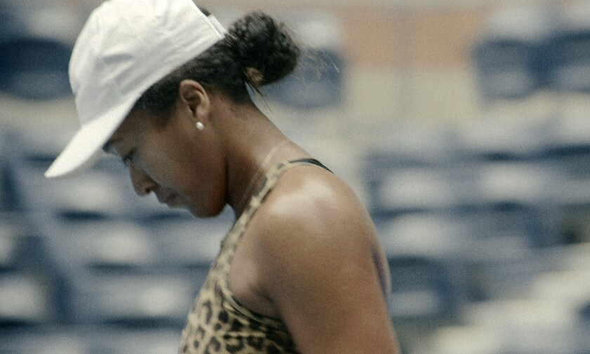 """This image released by Netflix shows Naomi Osaka in a scene from the docuseries """"Naomi Osaka,"""" premiering on July 16. (Netflix via AP)"""