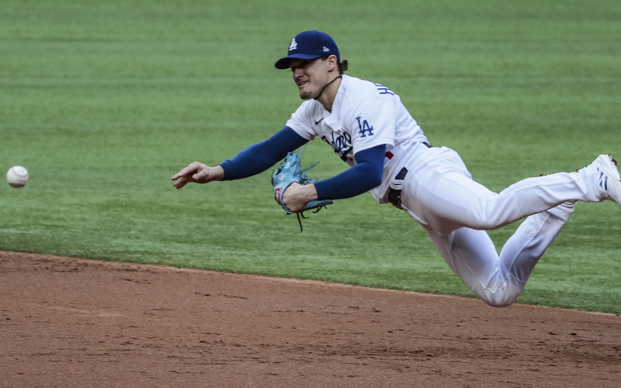 Dodgers second baseman Kiké Hernández tries to make a throw to first during the second inning.