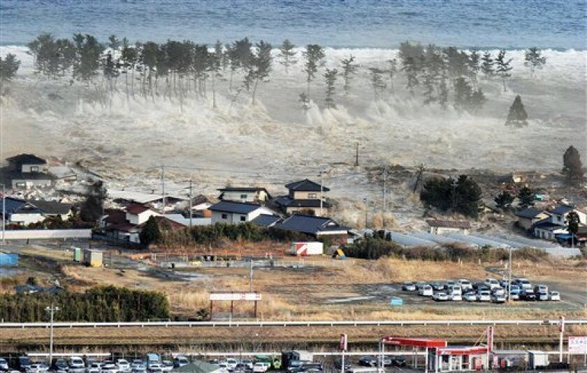 FILE -In this March 11, 2011 file photo, waves of a tsunami hit residences after a powerful earthquake in Natori, Miyagi prefecture (state), Japan.  A government-commissioned panel of experts said Saturday March 31, 2012 a tsunami unleashed by a magnitude-9.0 earthquake in the Nankai trough, which