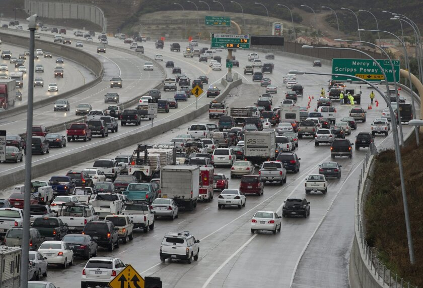 Traffic backs up on southbound Interstate 15 just north of Mercy Road, where solo drivers can buy into the carpool lane, which has variable pricing based on traffic congestion.