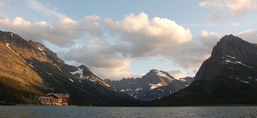 In Montana, Glacier National Park's Many Glacier Hotel looks out upon Swiftcurrent Lake. For a more intimate overnight, there's the Lake McDonald Lodge.