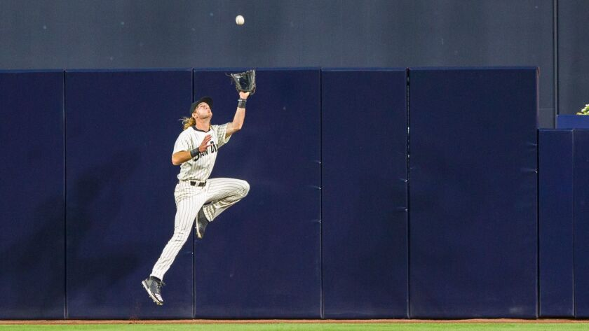 Padres center fielder Travis Jankowski makes a jumping catch at the wall to send the third inning, stranding two Red Sox runners on Sept. 7, 2016.