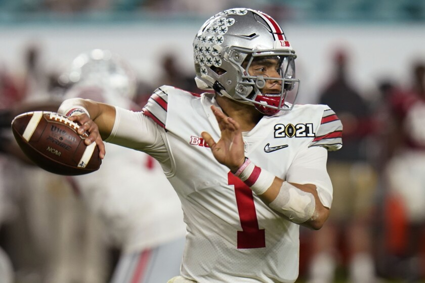 Ohio State quarterback Justin Fields passes during a game.