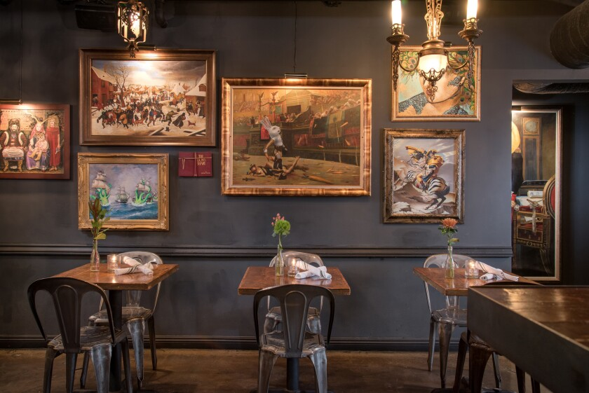 The Lion's Share is known for its eclectic artwork that hangs on walls around the bar and restaurant space in downtown San Diego.