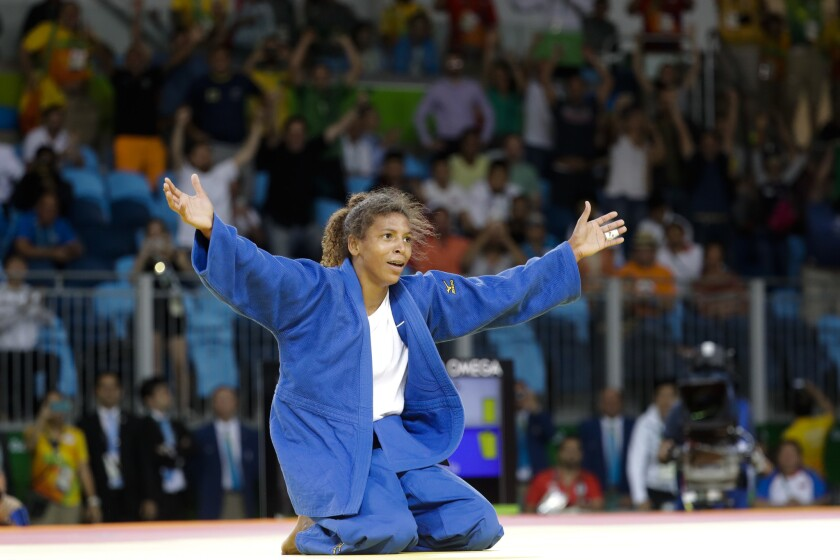 Rafaela Silva celebrates after winning the gold medal of the women's 57-kg judo competition in Rio de Janeiro.