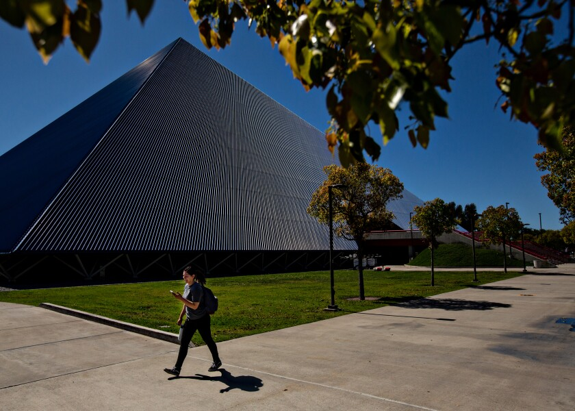 A student passes the Walter Pyramid at Long Beach State on March 11.