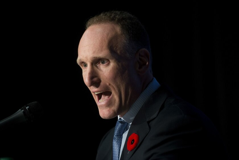 Toronto Blue Jays new president and chief executive officer Mark Shapiro answers questions at a press conference in Toronto on Monday, Nov. 2, 2015. (Marta Iwanek/The Canadian Press via AP)