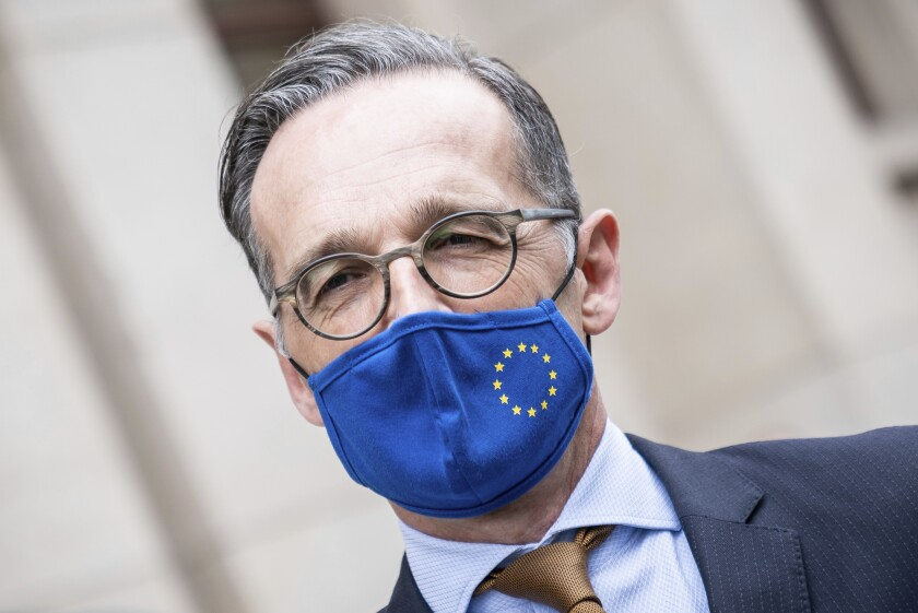 German Foreign Minister Heiko Maas, wears a face mask to protect against the coronavirus following a meeting with his Italian counterpart Di Maio at the Foreign Office in Berlin, Germany, Friday, June 5, 2020. (Michael Kappeler/Pool via AP)