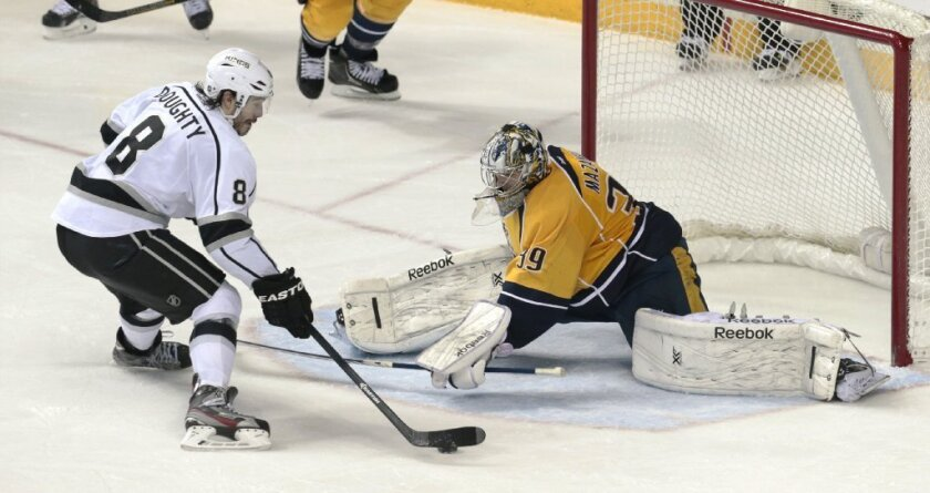 Nashville Predators goalie Marek Mazanec blocks a shot by Kings defenseman Drew Doughty.