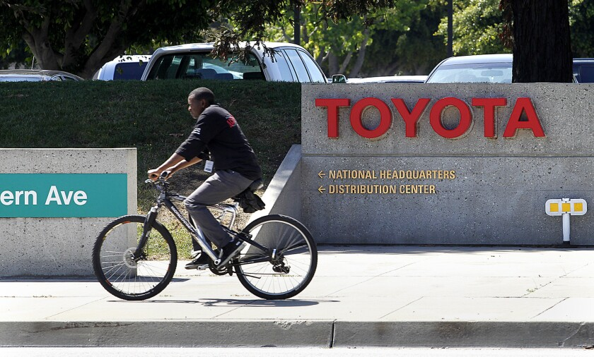 Toyota's U.S. auto financing arm, headquartered in Torrance, has agreed to pay restitution to black and Asian borrowers after federal regulators found those borrowers paid more than whites for their car loans.