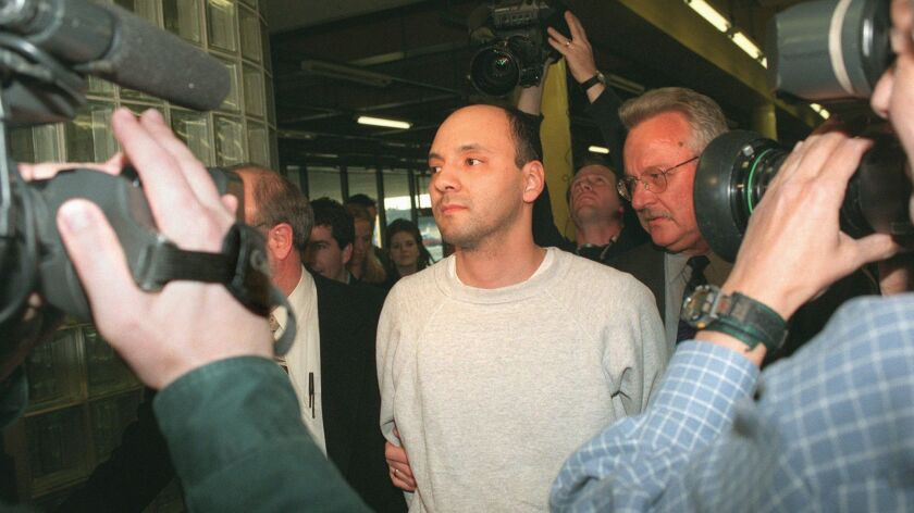 In this April 25, 1997 file photo, Andrew Urdiales walks in police custody at police headquarters in Chicago. Urdiales was convicted of murdering five women in Southern California more than two decades ago. An jury on Wednesday recommended that he receive the death penalty.