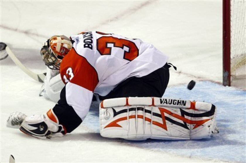 Philadelphia Flyers goaltender Brian Boucher lets in a a goal by Montreal Canadiens' Mike Cammalleri during the second period of an NHL hockey game on Monday, Dec. 7, 2009 in Montreal. (AP Photo/The Canadian Press,Paul Chiasson)