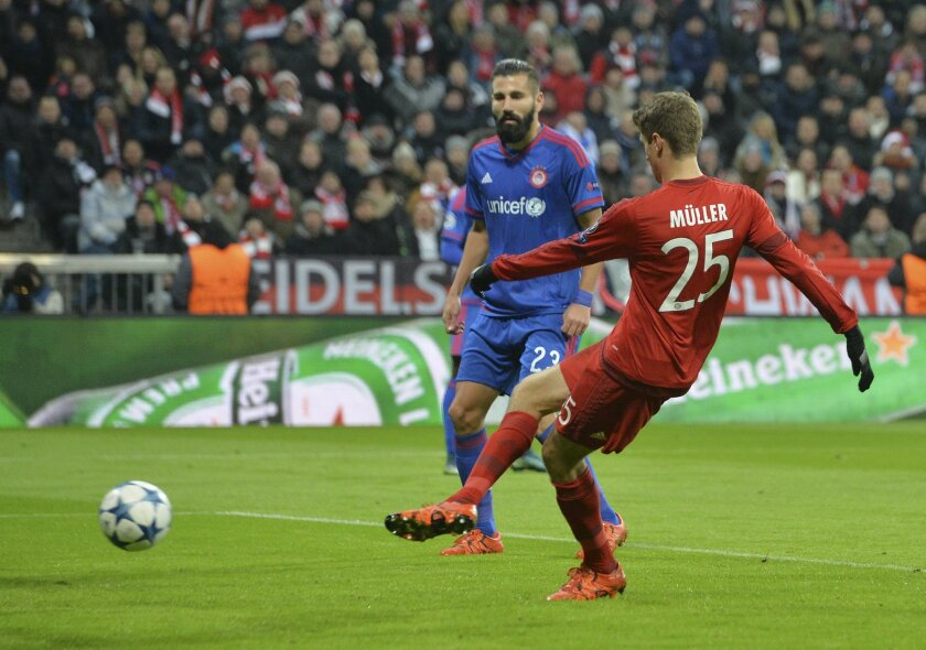 Bayern's Thomas Mueller scores a goal during the Champions League group F soccer match between FC Bayern Munich and Olympiakos in Munich, Germany, Tuesday, Nov. 24, 2015. (AP Photo/Kerstin Joensson)