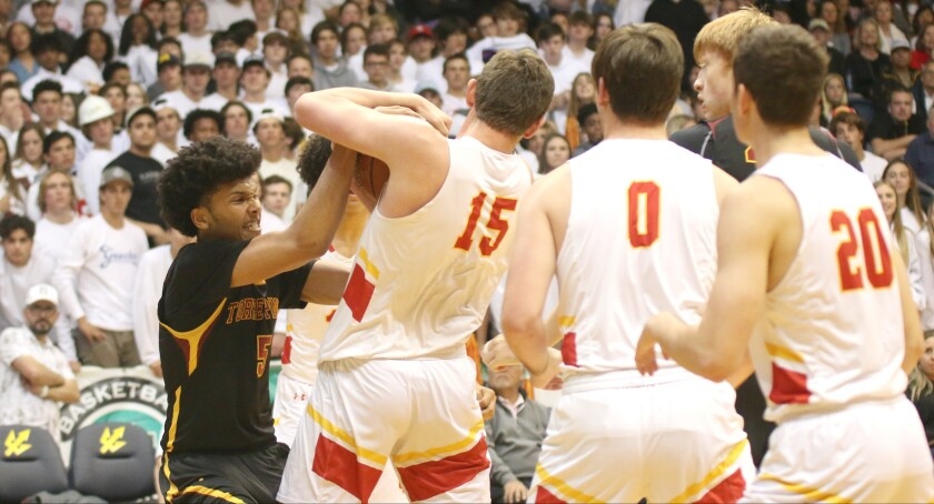 Junior Chris Howell (left) had 12 points and eight rebounds for Torrey Pines.
