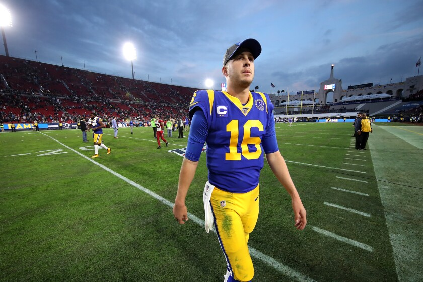 Rams quarterback Jared Goff walks off the field after a season-ending victory over the Cardinals at the Coliseum on Dec. 29, 2020.