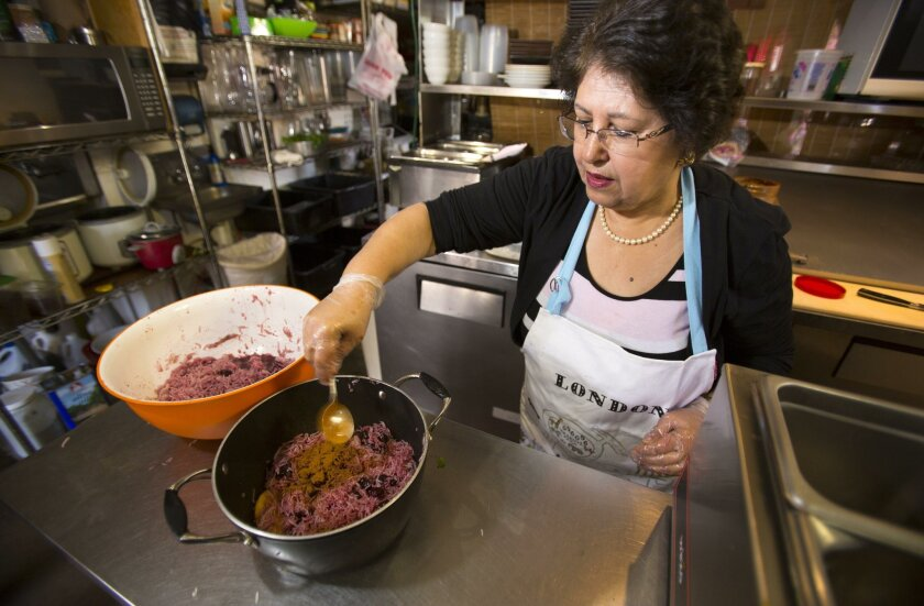 Mahin  Mofazeli, who owns Soltan Banoo in University Heights with her daughter Sanam Govari, prepares Albalu Polo basmati rice cooked with sour cherries.