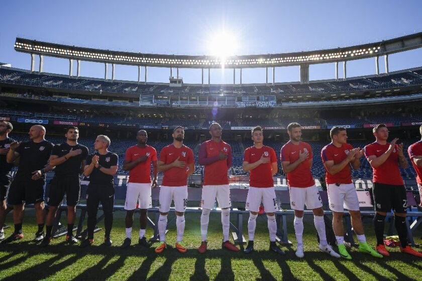 United States players line up during the national anthem before a soccer friendly against Serbia on Jan. 29 in San Diego.