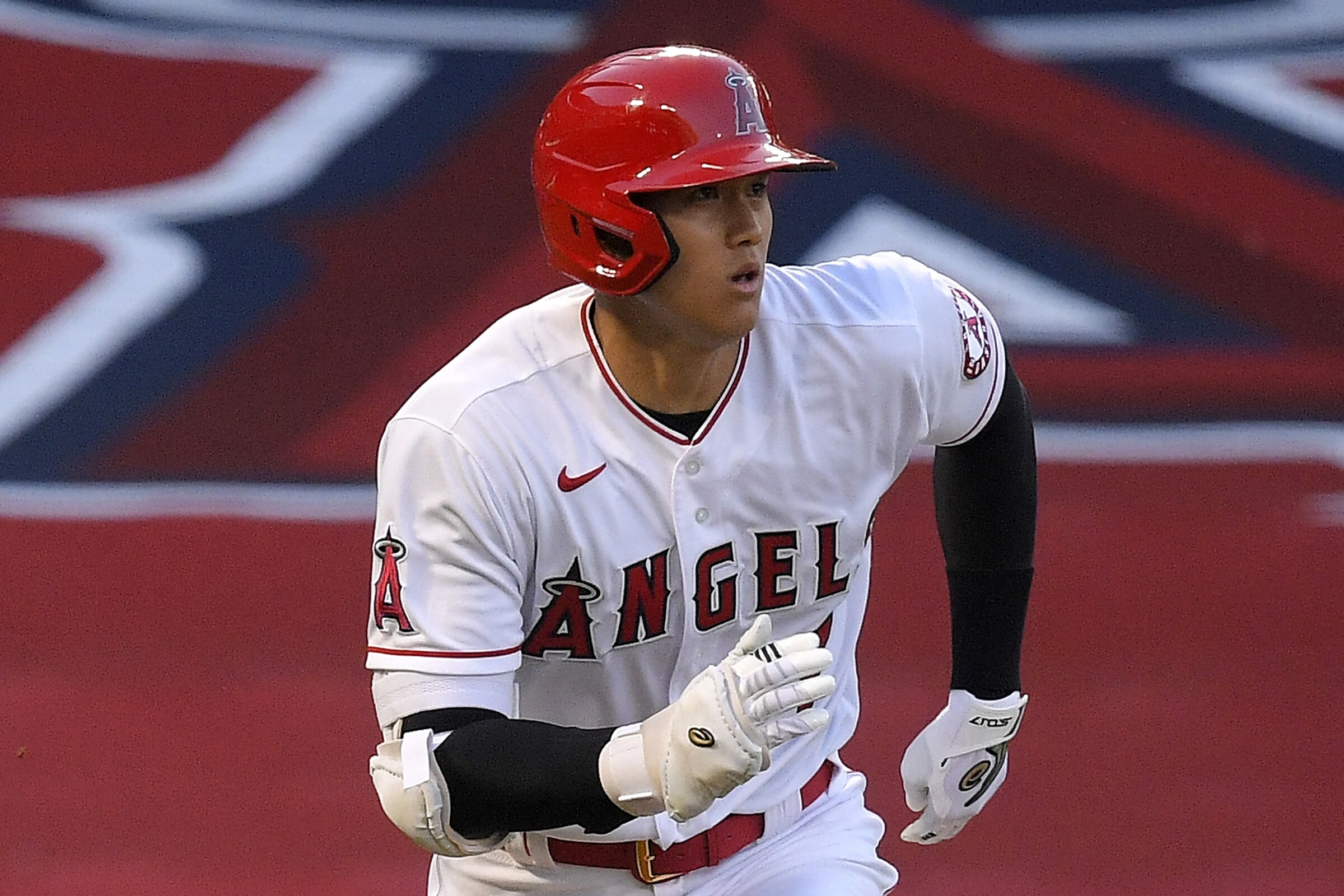 Angels' Shohei Ohtani runs to first against the Seattle Mariners on July 29