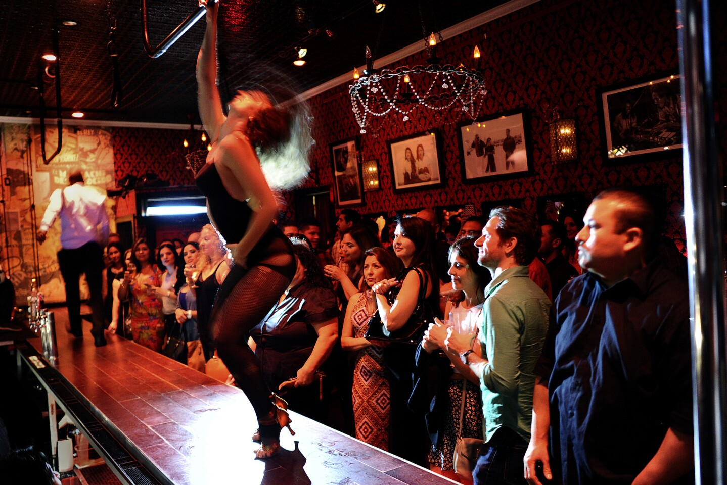 Customers enjoy a burlesque show on a Saturday night at the Eastside Luv wine bar in Boyle Heights. When it opened next door to Las Palomas in 2006, the neighborhood was hearing increasing chatter about imminent gentrification.