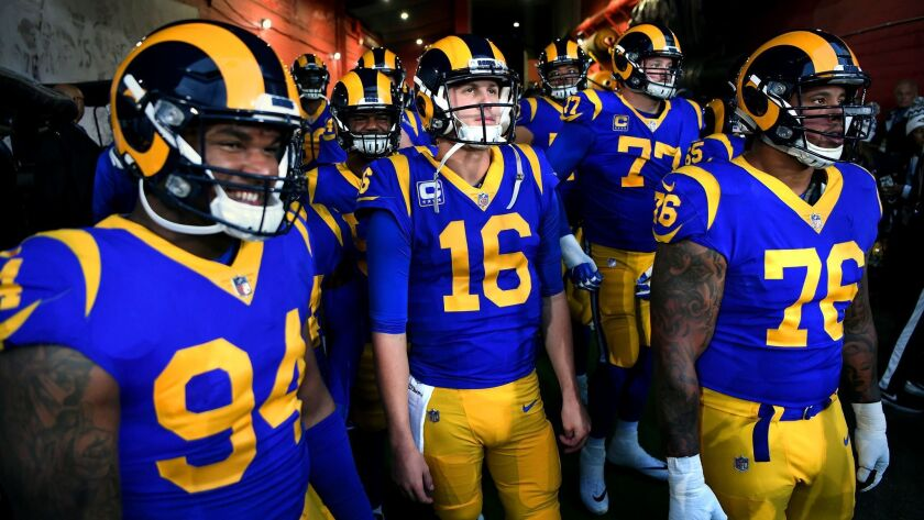 Rams quarterback Jared Goff prepares to take the field in a playoff game at the Coliseum. The team plays in the Super Bowl on Sunday.