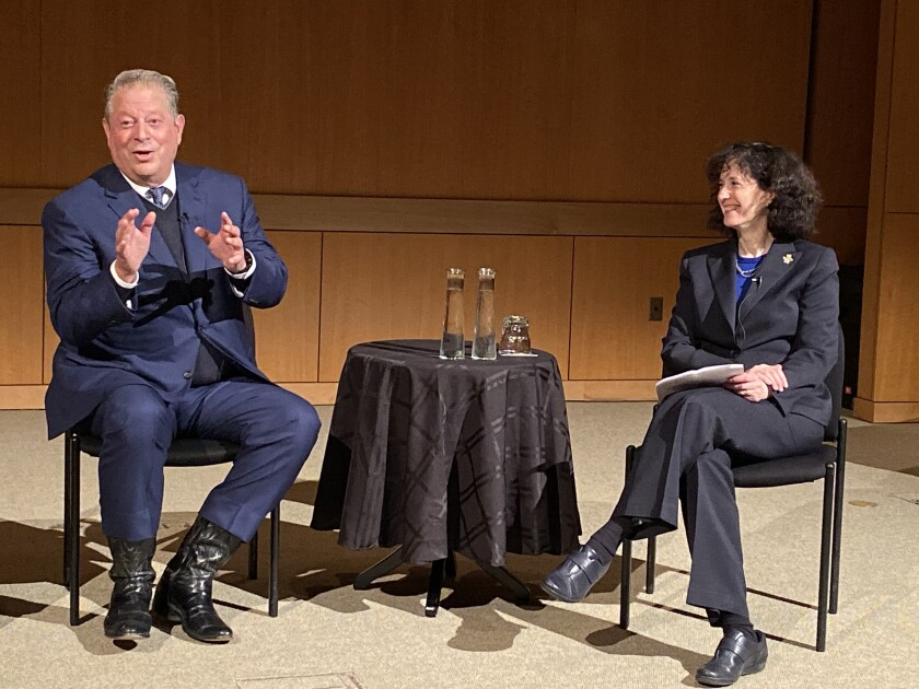 Gore addresses a packed crowd at the Salk Institute on Dec. 3, alongside the evening's moderator, UCSD executive vice chancellor for academic affairs Elizabeth Simmons.
