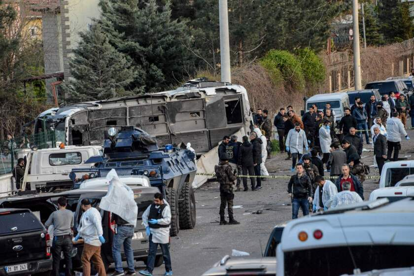 Police and civilians at the site of a bomb attack in Diyarbakir in southeastern Turkey on March 31, 2016.