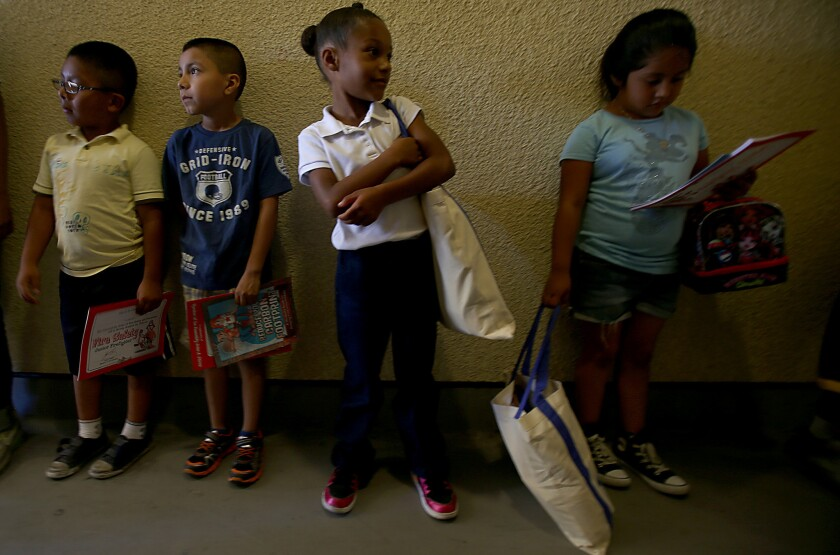 Students at Leo Politi Elementary School in the Pico-Union carry books and tote bags that they received during UCLA's Fifth Annual Volunteer Day.