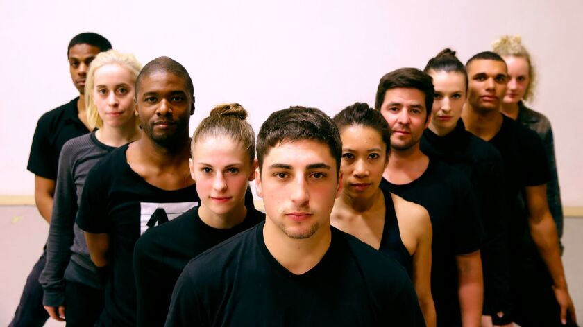 The dancers of Jacob Jonas the Company pause during a rehearsal for their show at the Wallis.