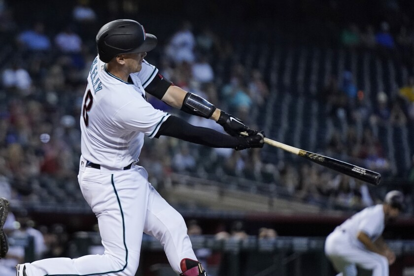Arizona Diamondbacks' Carson Kelly connects for a three-run home run against the Oakland Athletics during the second inning of a baseball game Tuesday, April 13, 2021, in Phoenix. (AP Photo/Ross D. Franklin)