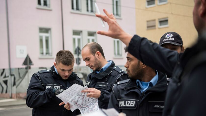 Police officers coordinate the evacuation of 60,000 residents in Frankfurt, Germany, Sunday, Sept. 3