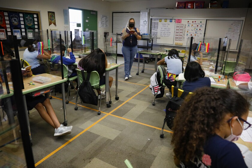 Smythe Elementary teacher Katherine O'Callaghan leads a discussion with her fifth-grade students on Wednesday.