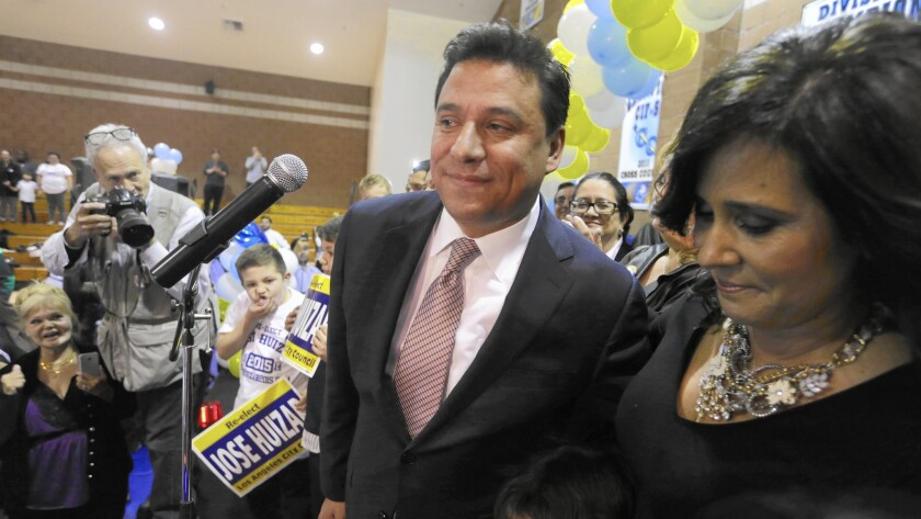 Councilman Jose Huizar acknowledges the help he received from his wife, Richelle, on election night at his headquarters at Salesian High School.