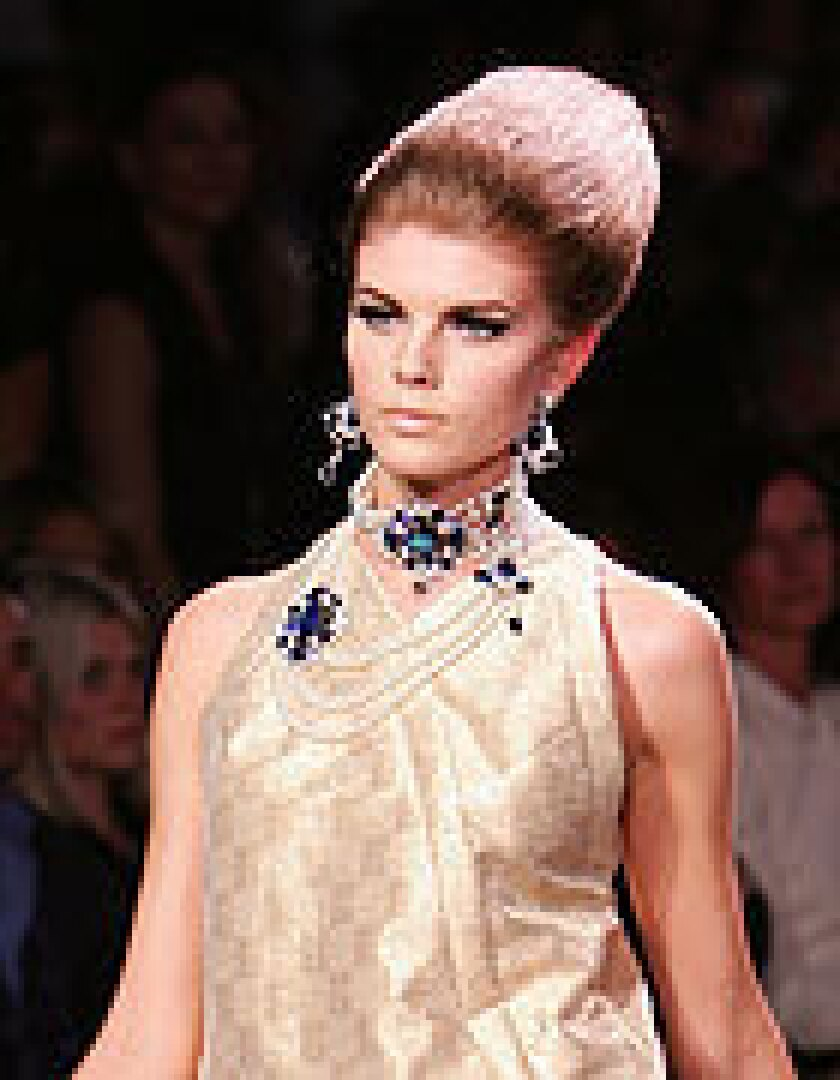 A Dior model in tamed beehive. (Bryan Bedder / Getty Images)