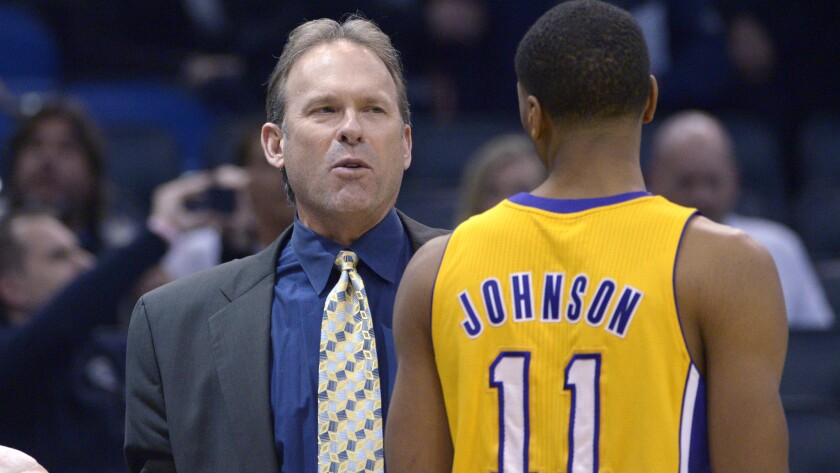 Lakers assistant coach Kurt Rambis, left, speaks with small forward Wesley Johnson during a game against the Orlando Magic in January. The Lakers have interviewed Rambis for their head coaching position.