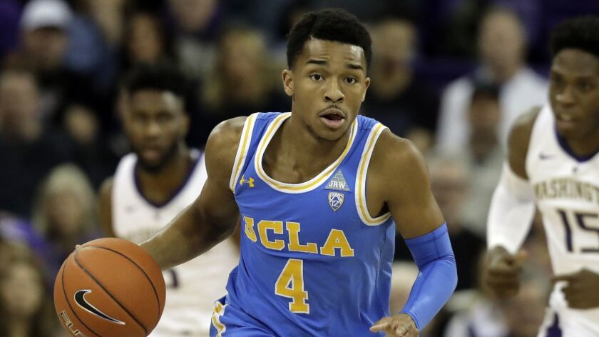 UCLA guard Jaylen Hands drives against Washington during the first half of an NCAA college basketbal