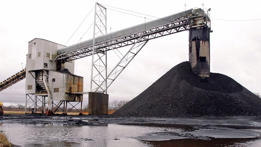 A conveyor belt moves underground mined coal to the surface at a Peabody Energy facility in Illinois. Peabody's 2016 bankruptcy filing may allow it to wriggle free of paying for the consequences of climate change.
