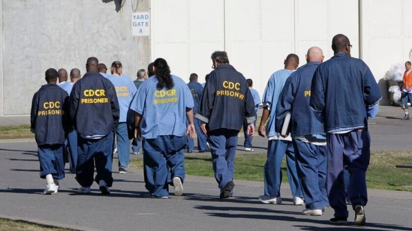 Inmates walk through the exercise yard at California State Prison Sacramento near Folsom in 2013.