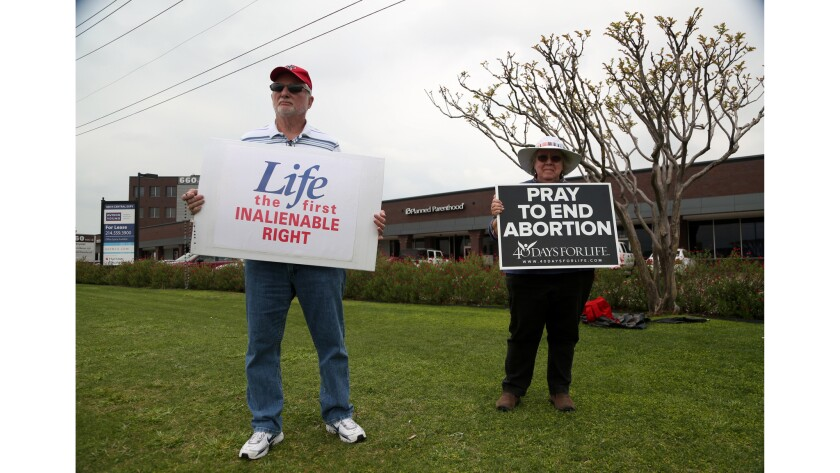 Charlie Kain and Mary Borchard, with the 40 Days for Life group, protest in front of a Planned Paren
