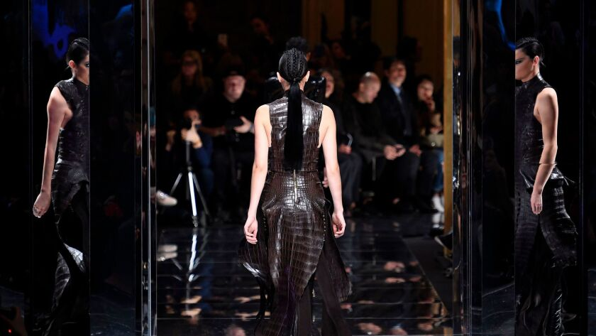 Kendall Jenner in a crocodile-textured dress at the Balmain fall/winter 2017 runway presentation on March 2.