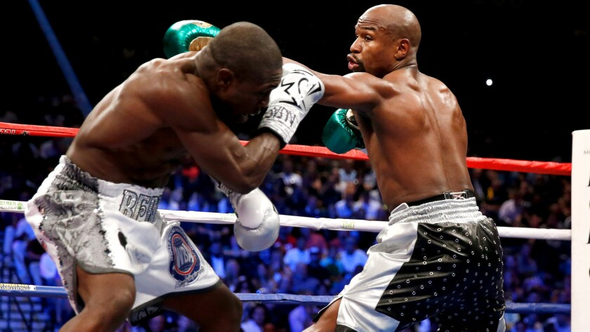 Andre Berto tries to block a left jab from Floyd Mayweather Jr. during their welterweight title fight on Saturday night at the MGM Grand Garden Arena.