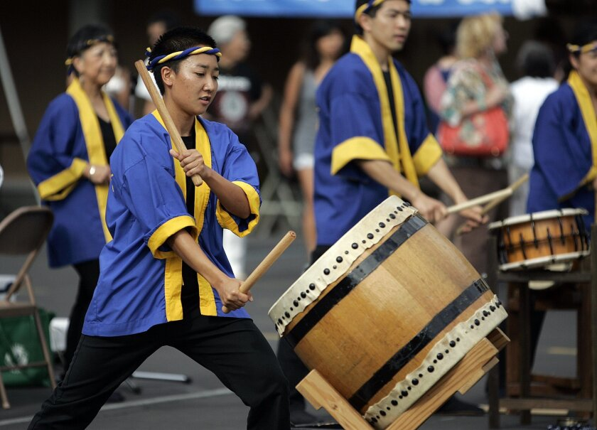 Laura Yamaguchi strikes her taiko during a performance at the Bon Odori, or Gathering of Joy, at the Buddhist Temple of San Diego in Grant Hill Saturday.