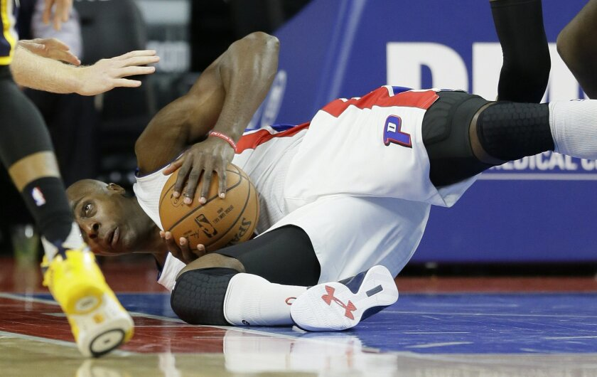 Detroit Pistons forward Anthony Tolliver controls a loose ball during the first half of an NBA basketball game against the Indiana Pacers, Tuesday, Nov. 3, 2015, in Auburn Hills, Mich., (AP Photo/Carlos Osorio)