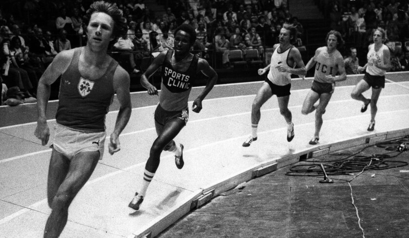 Eamonn Coglan leads Filbert Bayi en route to breaking the indoor mile world record at the San Diego Sports Arena in 1979.
