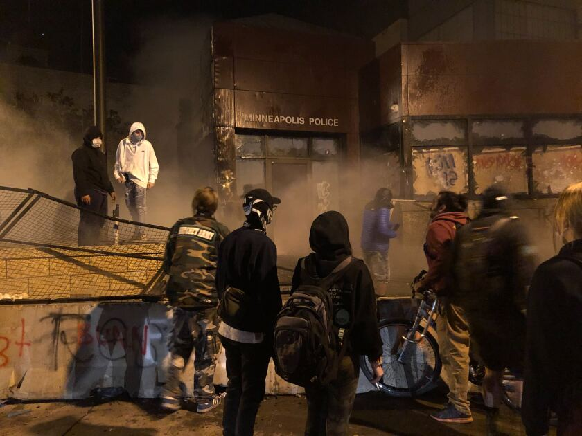 The Minneapolis 3rd Precinct station was overrun by protesters late Thursday.