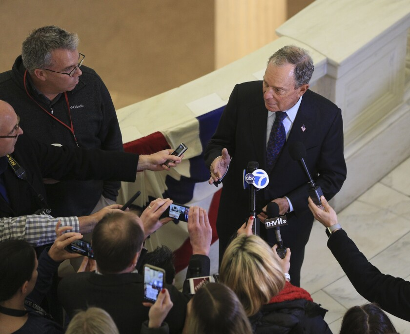 Former New York City Mayor Michael Bloomberg talks with reporters after he filed paperwork, Tuesday, Nov. 12, 2019, at the state Capitol in Little Rock, Ark., to appear on the ballot in Arkansas' March 3 presidential primary. Bloomberg hasn't formally announced a bid for the Democratic presidential nomination, but his trip to Arkansas is the latest indication that he is leaning toward a run. (Staton Breidenthal/The Arkansas Democrat-Gazette via AP)